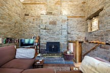 The woodburner can cosy up the room in no time. Firewood comes from the grounds and is sustainable.
