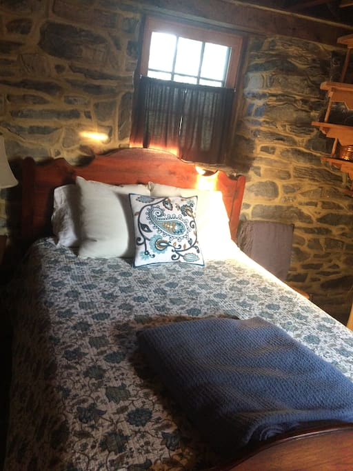 Full bed in stone house