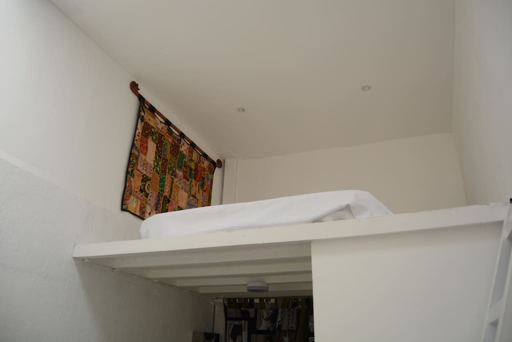 Full Double bed upstairs on the mezzanine.