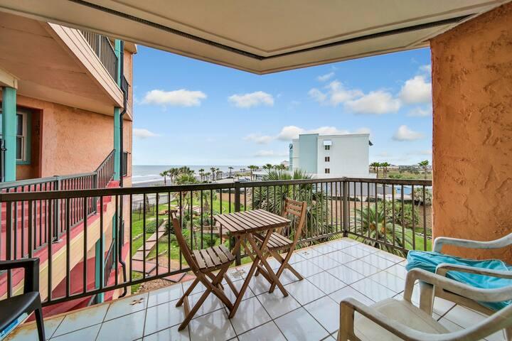 Beautiful condo with balcony view & short walk to the beach
