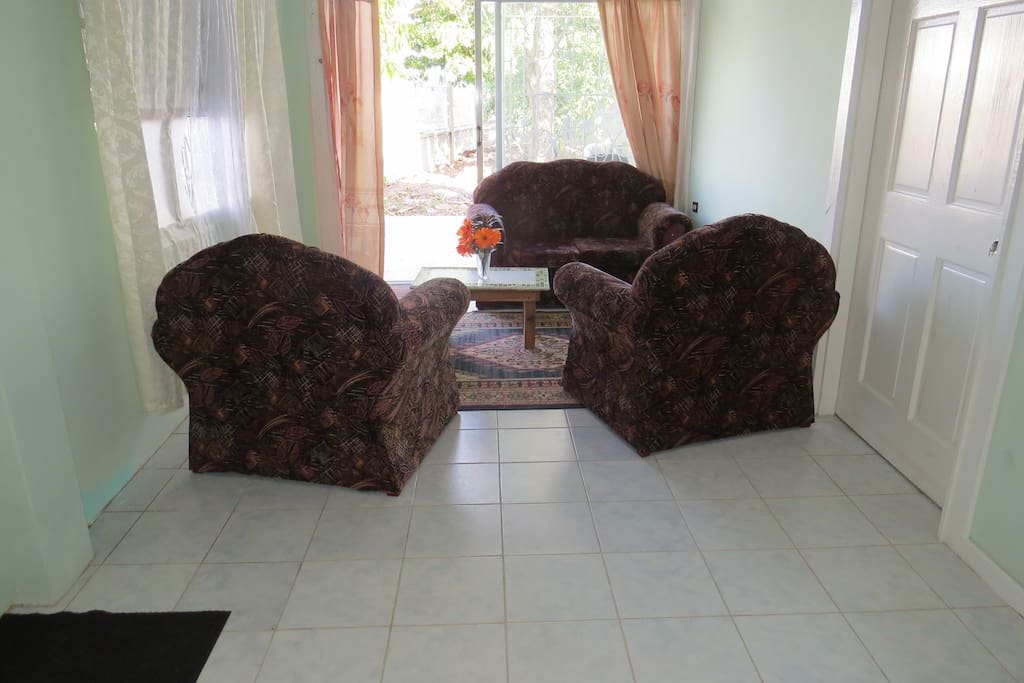 Spacious sitting area with sliding patio doors to sitting area and garden