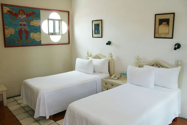 Two beds in a clean room. Htl - Isla Mujeres - House