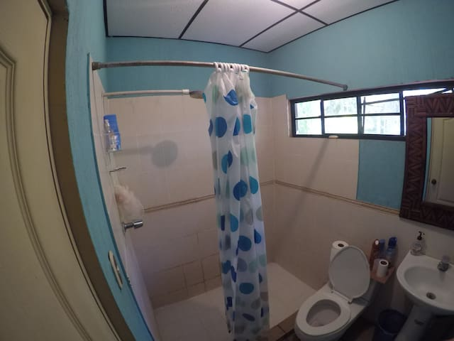 Shared bathroom for rooms 2 & 3 located on the second floor.