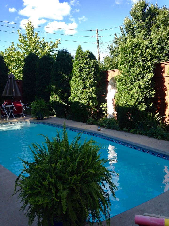 Unwind in our private heated pool - and urban oasis with a 10 foot privacy fence.