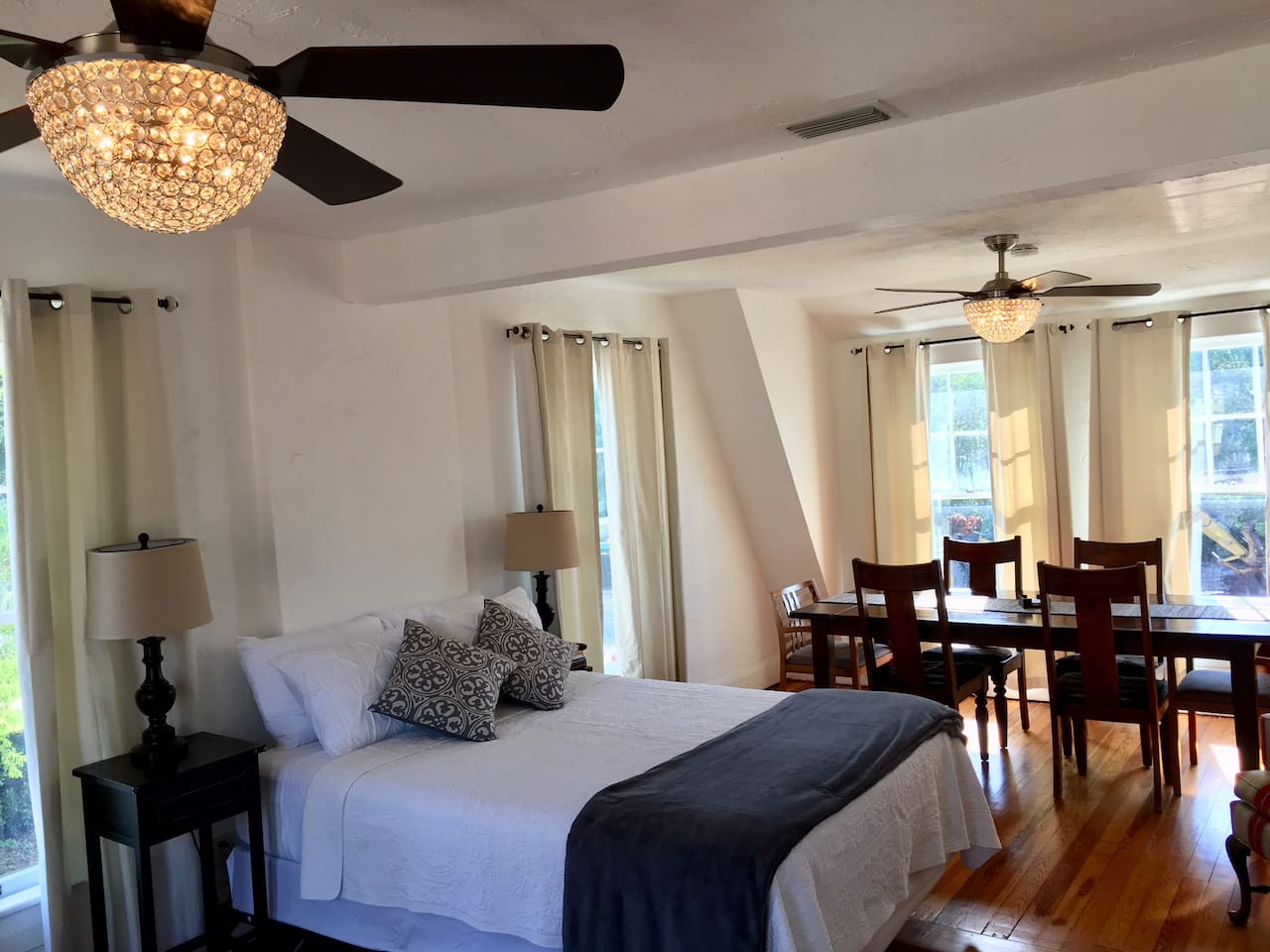 Newly renovated, furn., non-smoking 1 BR, 1 private bath. Coffee shop, craft beer/wine bar, a café w/ light bites,  bookstore, laundry. Courtyard. Located near Downtown, Beaches, Bay, & attractions. Light live music (acoustic guitar and jazz).