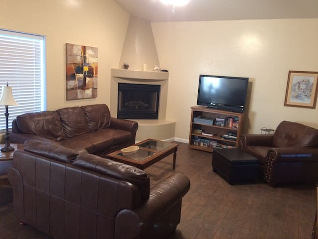 Comfortable Living Room with ample seating, lake views and Dish TV!