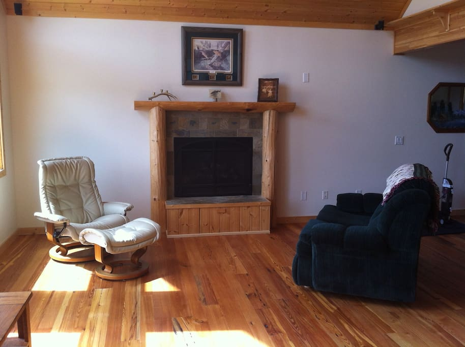 Living Room reading area near fireplace.  Love seat makes into a twin bed.
