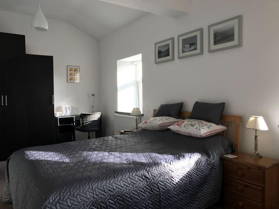 Spacious bedroom with modern en suite