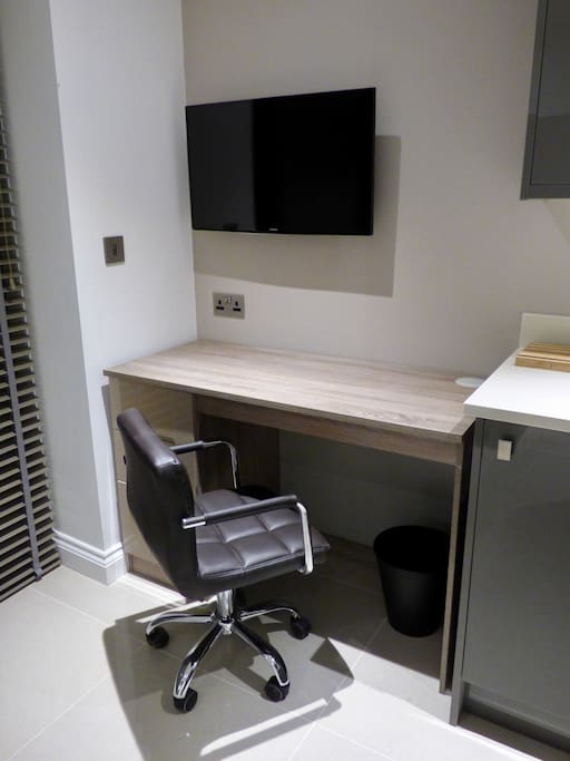 """Dining And Study Area With 32"""" Smart HD TV connected to complimentary wifi"""