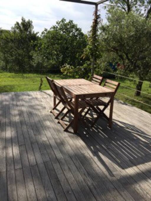 The deck. There is a second table and both have leaves which go on either end