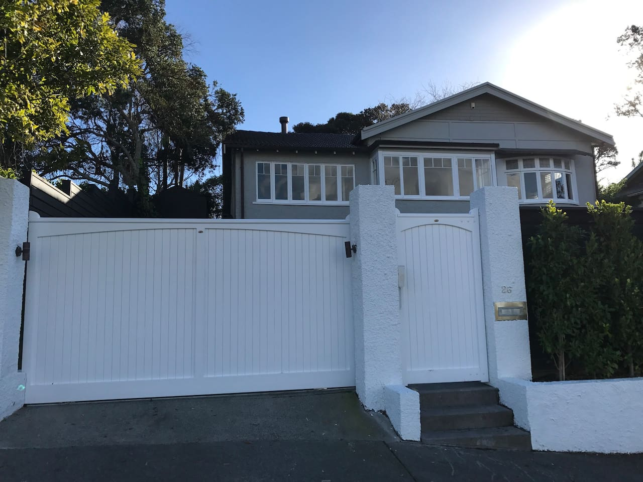 Fully fenced with automatic driveway gates, intercom and pin pad access on pedestrian gates for your security.
