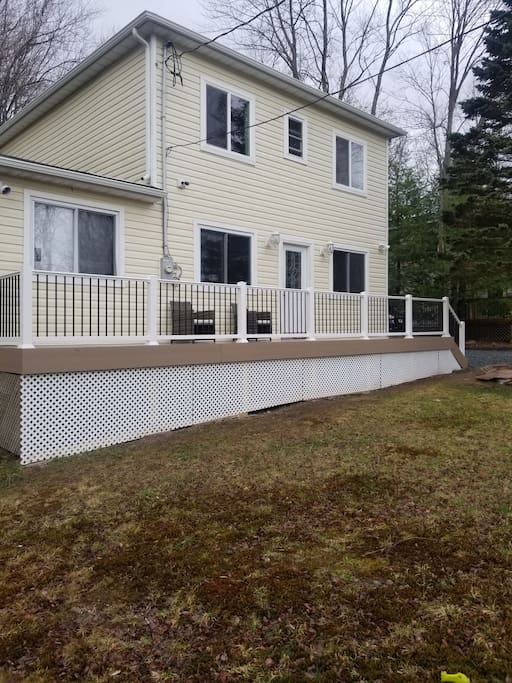 Front of house with new deck