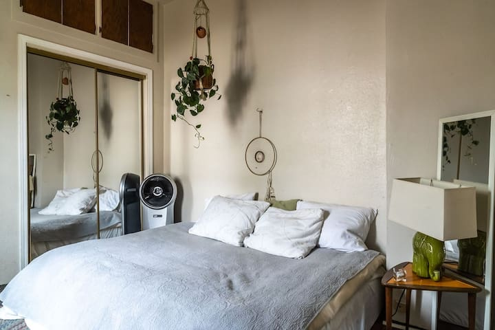 The bedroom is simple, with a humidifier/fan, comfortable thick mattress on the floor with 100% cotton sheets and a quality down blanket. One side of the closet is available for guests.