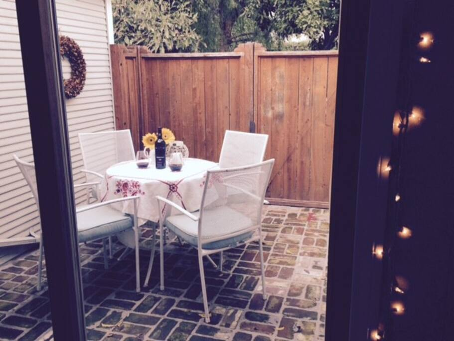 Private porch with dining area.