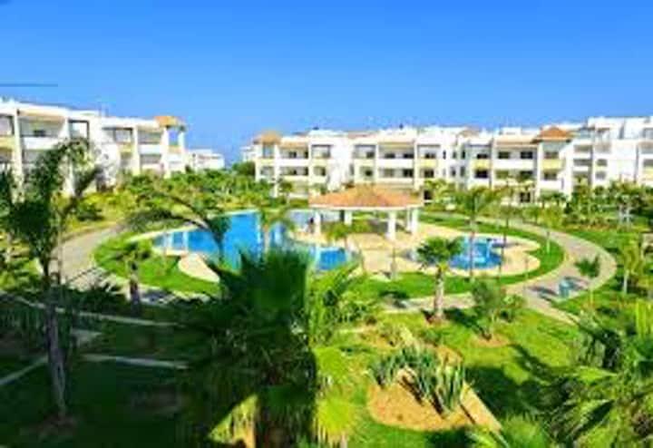Wohnung mit einem Schlafzimmer in Assilah mit herrlichem Meerblick, Pool und möbliertem Garten - 100 m vom Strand entfernt