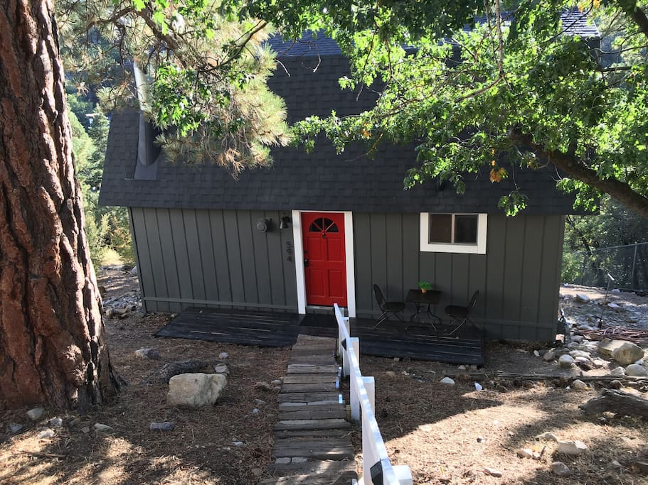 The cabin is situated below street level. There are 30 steps from the driveway to the front entrance.
