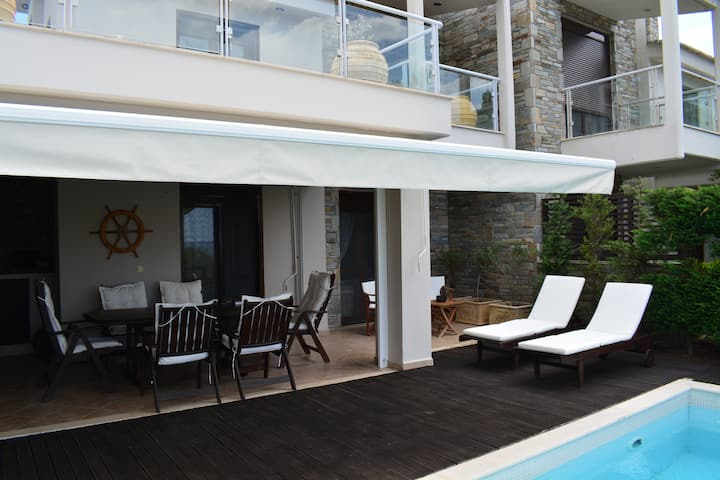 Azapiko beachfront 3 story villa with pool