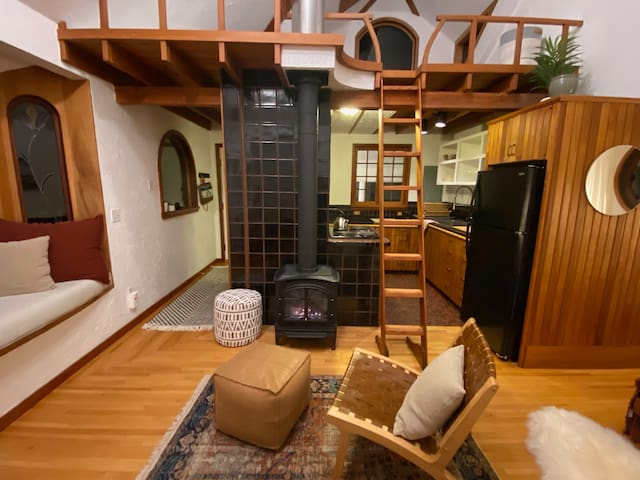 Open concept studio, with reading loft. Mahogany woodwork throughout.