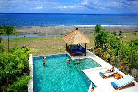 Feel the magic of bali in a beachfront villa