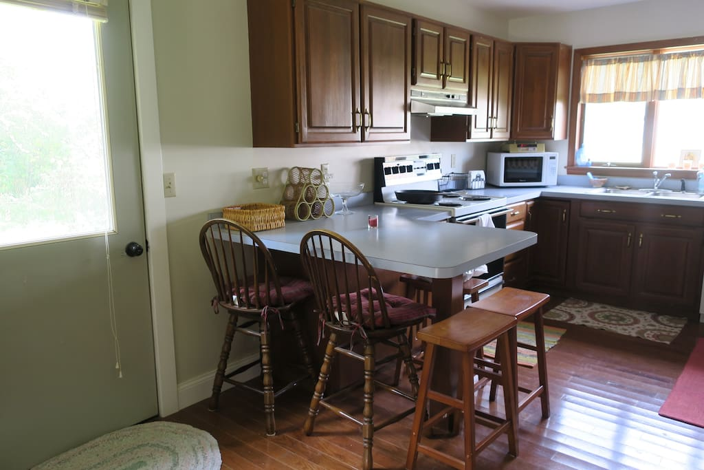 Past the dining room, you'll walk right into the kitchen. This is where the magic happens! There's an exit to the yard on the left hand side.