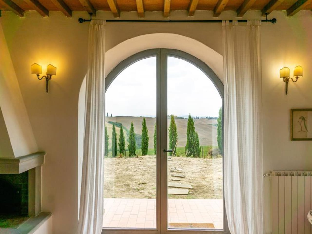View from the living room, green garden in progress, #cretesenesi out the window