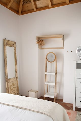 A full length mirror, chest of drawers, closet with hangers and a mobile vanity stand to hold your toiletries and makeup.