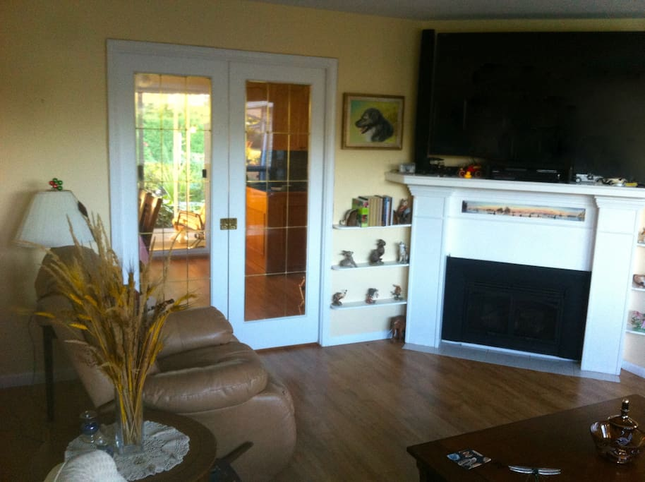 """Living room with fireplace shown and the 60 """" TV for your use...300 DVD's to choose from"""