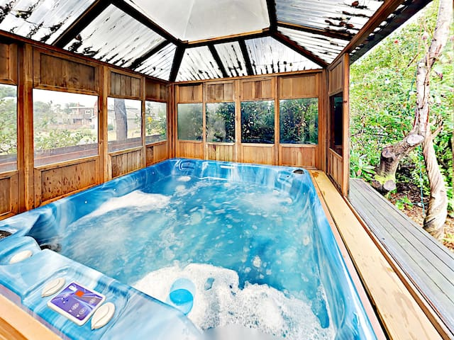Relax in your own private, covered hot tub.