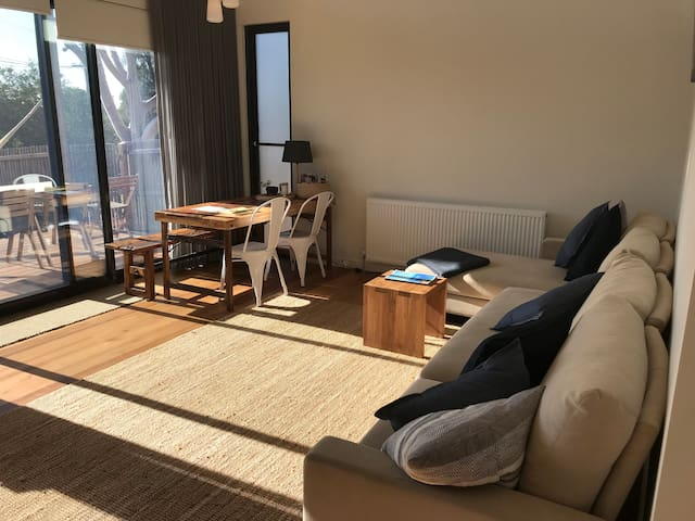 Sunfilled north facing living area. King living houdini couch converts to two single beds or second king bed