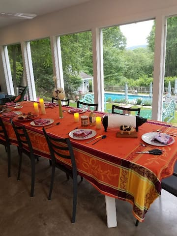 Dining on the screened in porch overlooking the pool and gardens.