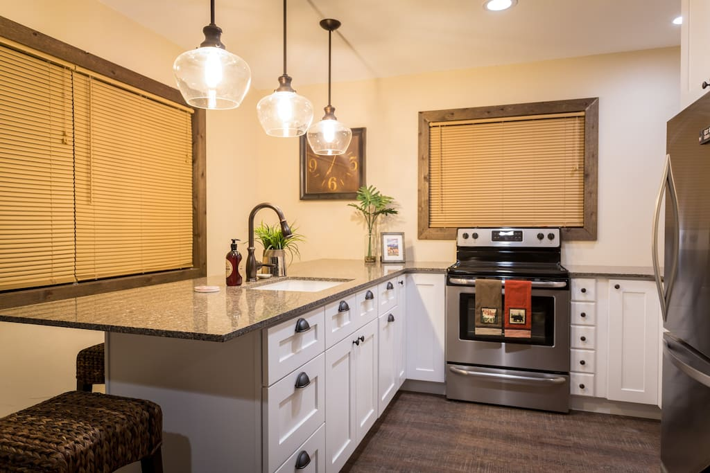 Full kitchen with countertop seating for four