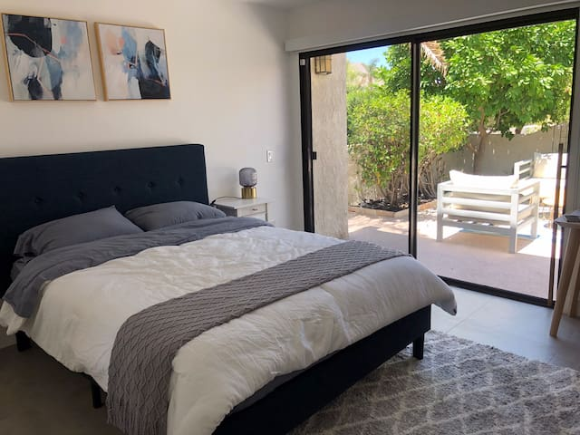 3rd bedroom with queen bed. Opens up to large patio