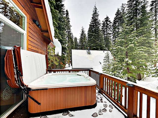 A private hot tub awaits on the balcony.