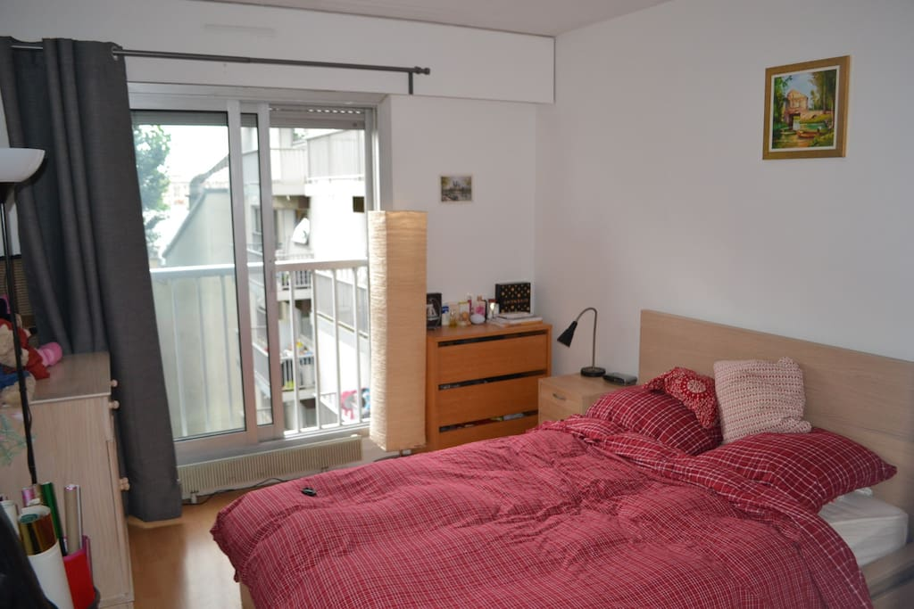 Bedroom with double bed and big windows