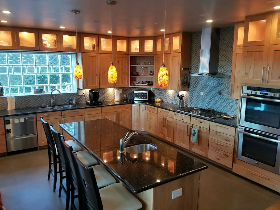 Stunning, massive chef worthy kitchen with eat-in island.