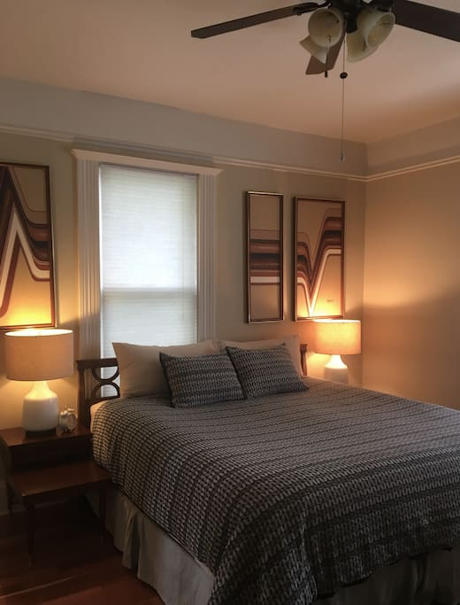 Ceiling fan above bed