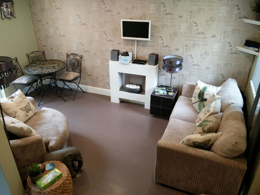 Lounge & diner with electric fireplace, tv & dvd combo, BT youview box & CD player /digital radio.