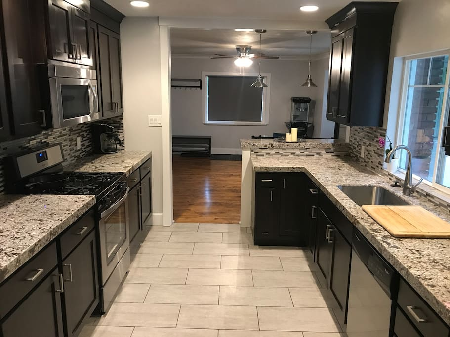 Kitchen fully loaded with dishes, cookware, and appliances.