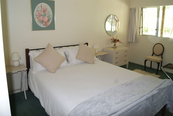 First bedroom with queen bed.