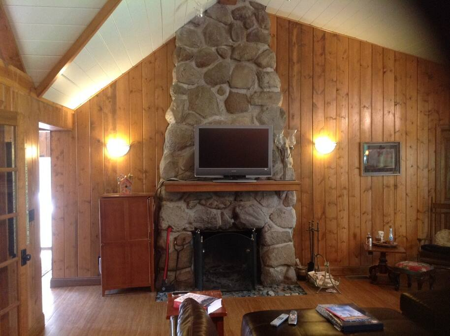 Original wood burning stone fireplace in living room