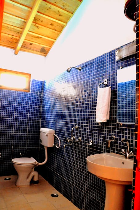 Well maintained attached bathrooms with modern fixtures and amenities.