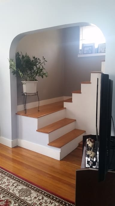 The stairs off the living room, right as you enter