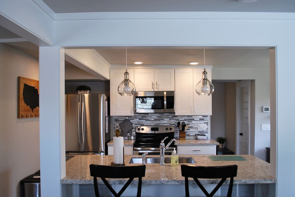 Fully equipped kitchen with bar seating for 2