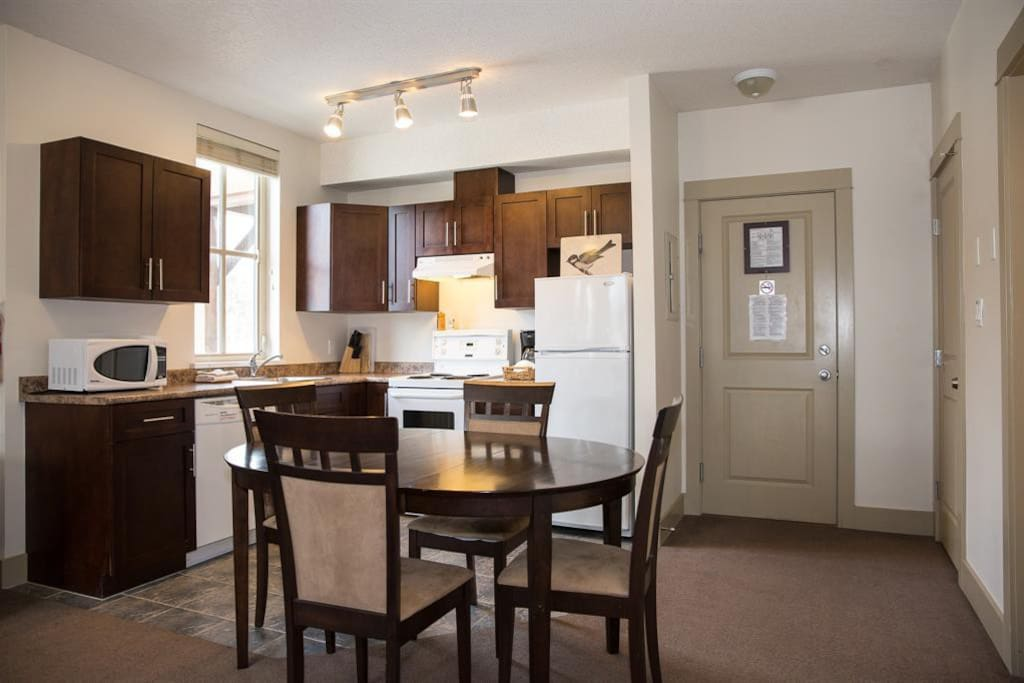 Fully stock kitchen with dining area, Pemberton Gateway Village Suites