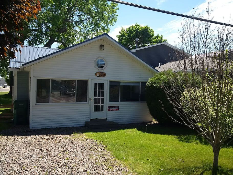 New paint and carpet inside, new windows, vinyl siding and metal roof outside!
