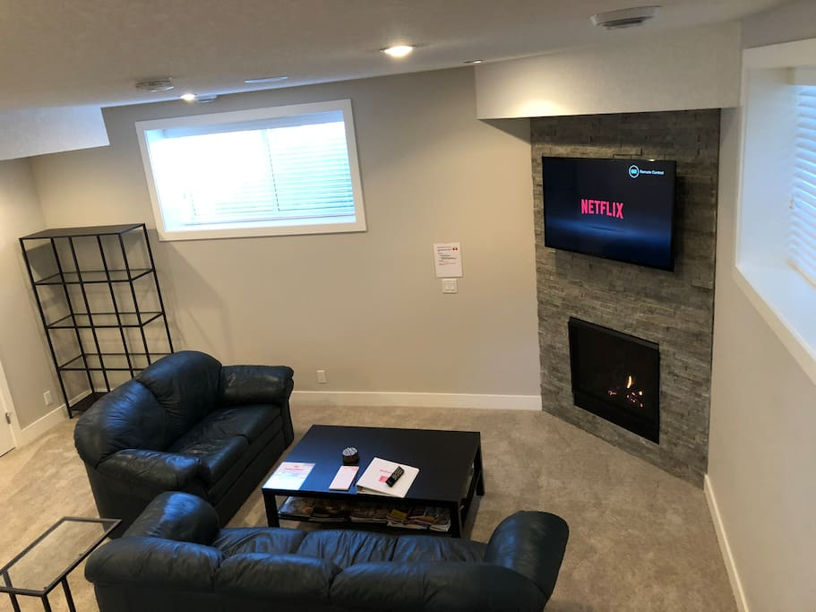 Relax in the living room area with fireplace and big screen TV
