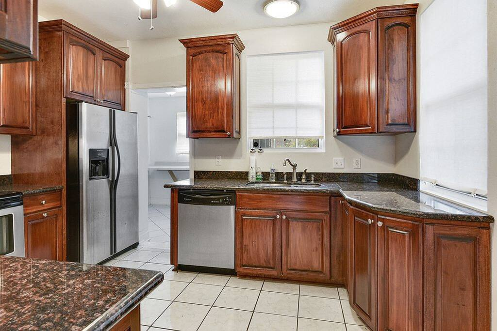 Newly renovated kitchen with all appliances, including dishwasher.  Laundry room adjacent to kitchen.