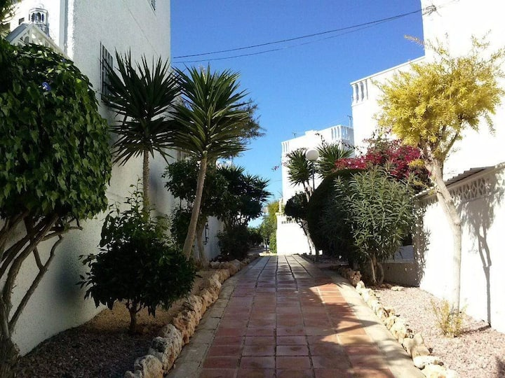 White beach house with large terraces (La Mata)