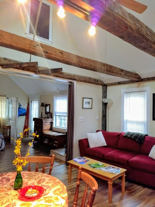 Original beams and cathedral ceilings in both rooms
