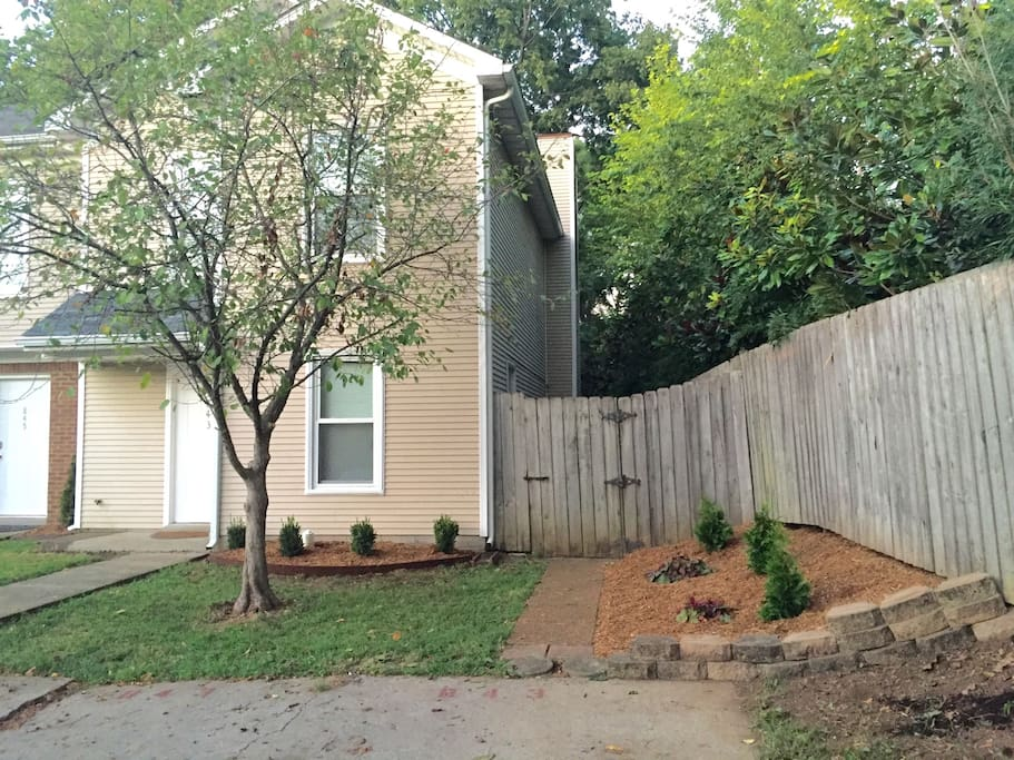 The side gate can be used to access the back patio.  Parking is directly in front of the townhouse.